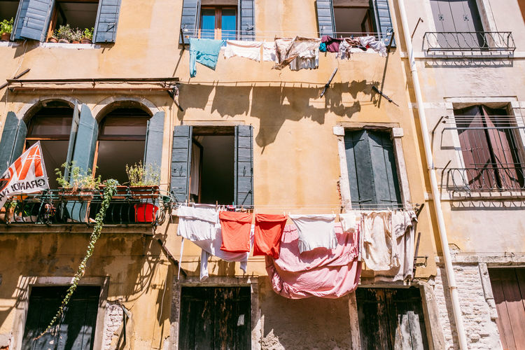 Venice Building Exterior Architecture Built Structure Building Window Residential District Clothesline Hanging Drying Low Angle View Laundry Clothing Textile Day No People City Balcony Sunlight Outdoors House Apartment