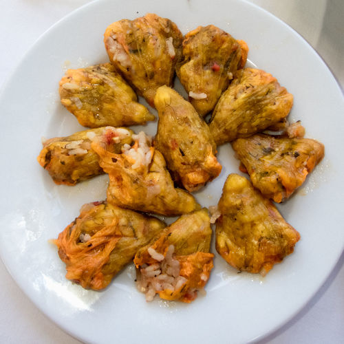 Zucchini flowers, stuffed with rice Cuisine Greek Rice Stuffed Vegetarian Close-up Cretan Flowers Food Food And Drink Freshness Greek Food Healthy Eating Plate Ready-to-eat Serving Size Traditional Zucchini Flower Zuchini