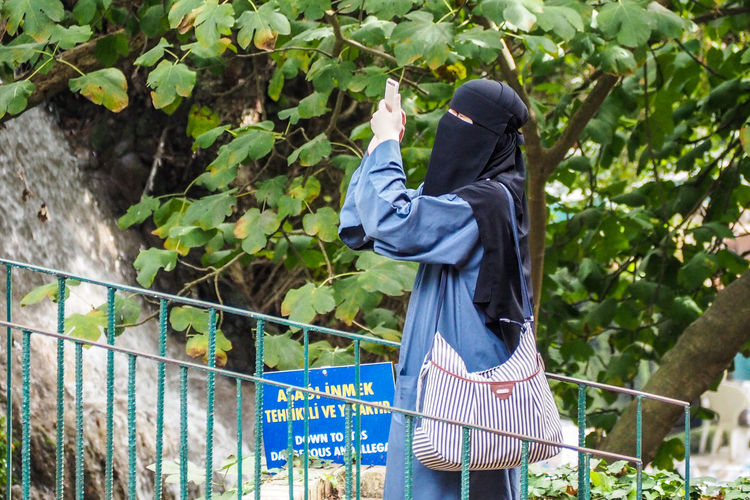 Day Islam Nature One Person Outdoors People Railing Real People Tree Turkish Women Women With Headdress