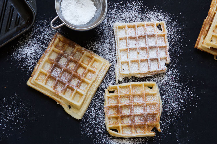 High Angle View Of Waffles With Icing On Table