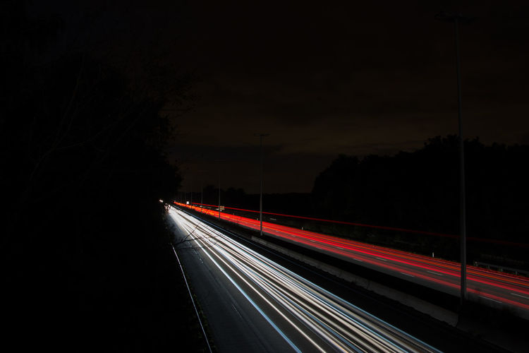 Speed Night Light Trail Transportation Illuminated Long Exposure Traffic Motion City Life No People Red Outdoors Road City