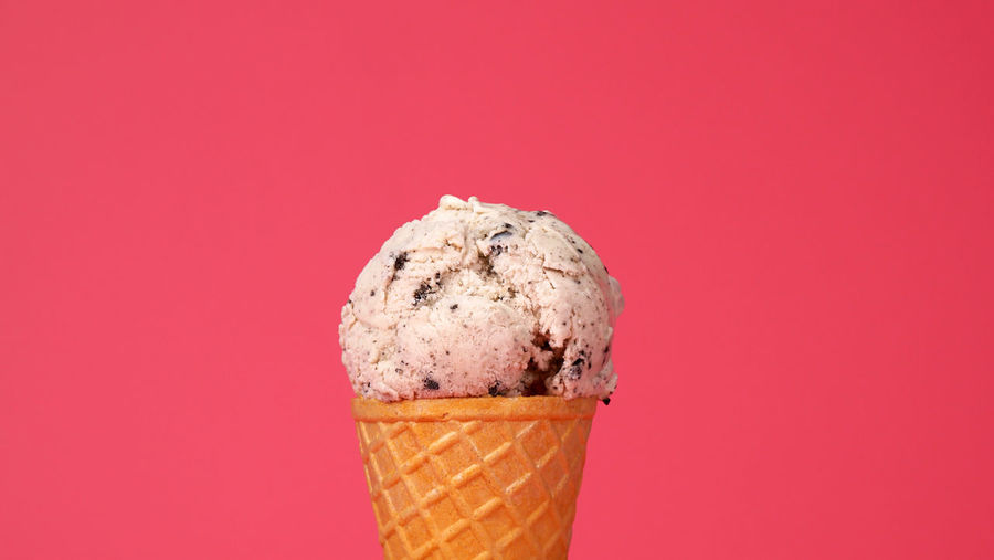 Close-up of ice cream against red background