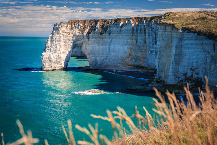 Beauty In Nature Cliff Coastline Day France No People Non-urban Scene Normandie Outdoors Rock - Object Rock Formation Sea Tourism Tranquil Scene Travel Destinations Water étretat Miles Away