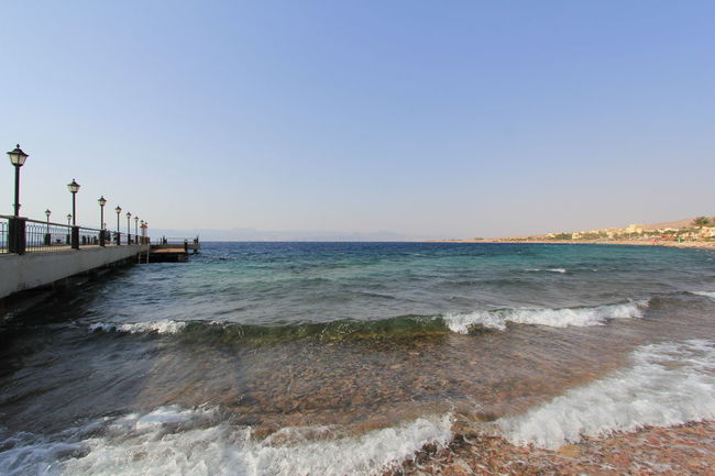 Beach Sea Water Sand Sunny Sky Travel Destinations Clear Sky Outdoors Vacations Tourism Summer Horizon Over Water Beauty In Nature Blue Wave Nature Sunlight Travel Swimming Aqaba Bay Aqaba Gulf Aqaba Jordan Jordan Aqaba