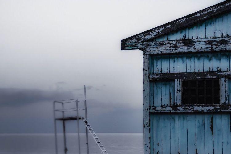Beach hut against sea