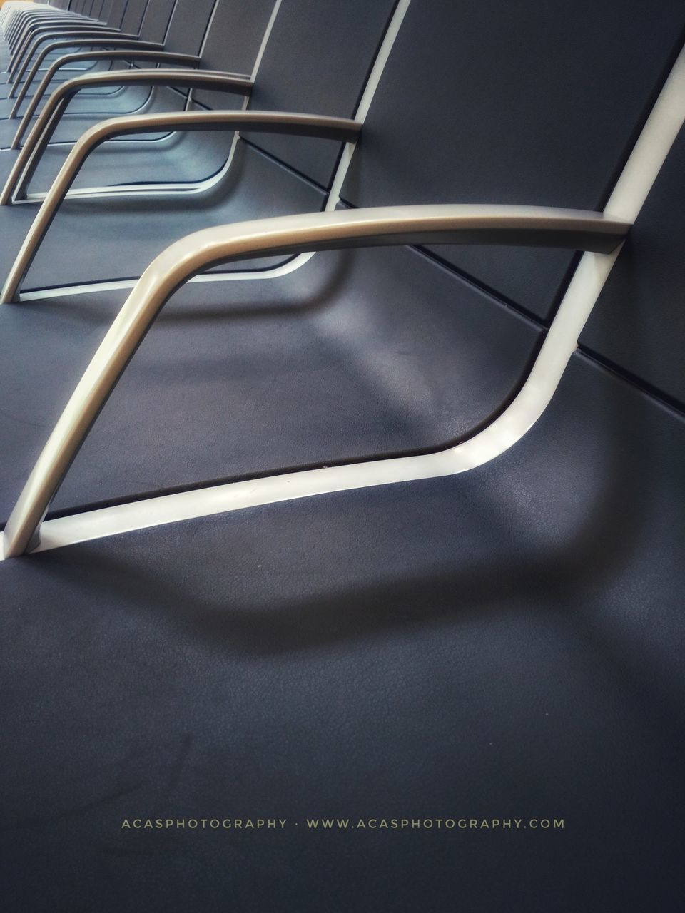 shadow, no people, indoors, empty, absence, seat, chair, high angle view, table, metal, close-up, still life, day, sunlight, communication, furniture, connection, nature