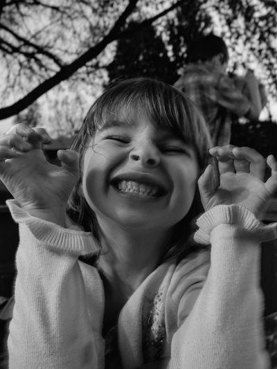 Close-Up Of Playful Girl At Park