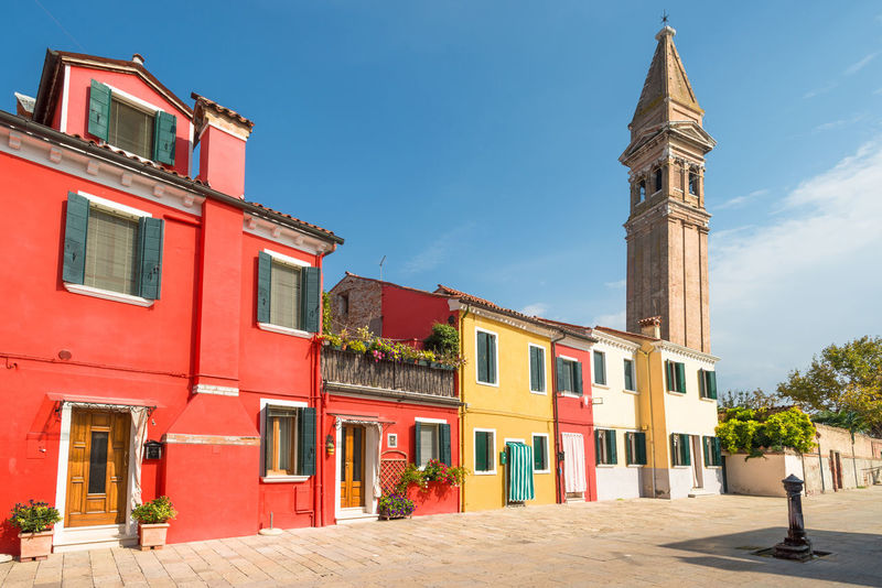 Colorful buildings and a leaning tower of an old church on Burano island, Venice, Italy. Architecture Architecture Building Building Exterior Built Structure Burano Burano, Italy Church City Colorful Day Italy Leaning Tower No People Outdoors Red Sky Tower Venice Yellow