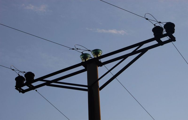 Low angle view of power line against sky