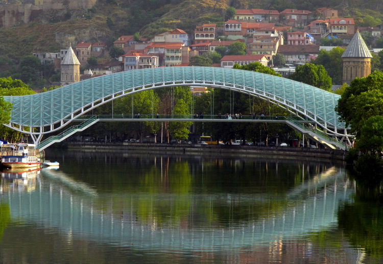 Tbilisi's Bridge of Peace in afternoon light Tbilisi Architecture Bridge - Man Made Structure Building Exterior Built Structure City Connection Day Nature No People Outdoors Reflection River Travel Destinations Tree Water Waterfront An Eye For Travel #urbanana: The Urban Playground