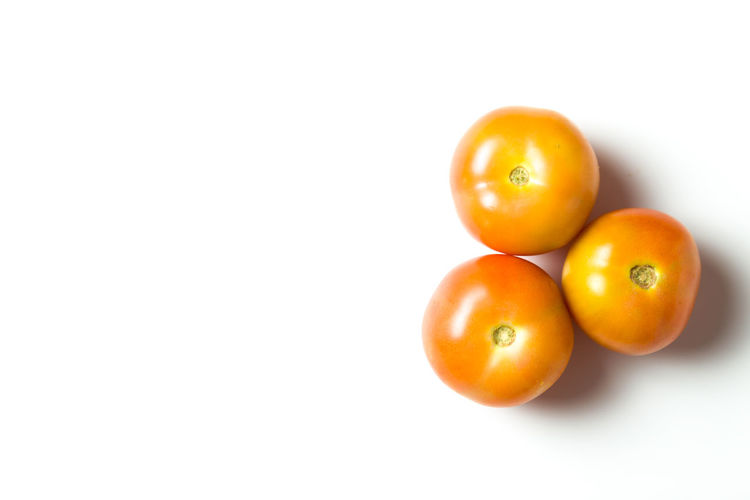 A group of tomatoes isolated over white background Backgrounds Close-up Cooking Day Exotic Food Food And Drink Fresh Freshness Freshness Fruit Fruits Growth Health Healthy Healthy Eating Mammal No People Nutrition Skin Sky Studio Shot Tomatoes White Background