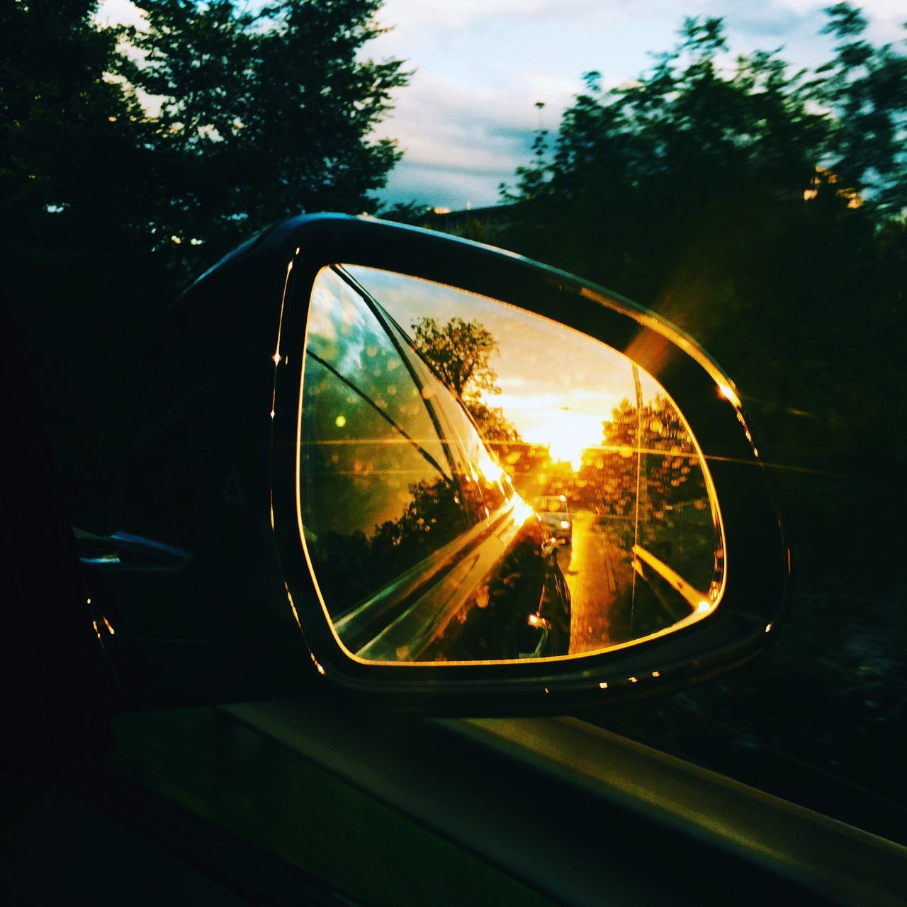 Reflection Of Sunlight In Side-View Mirror