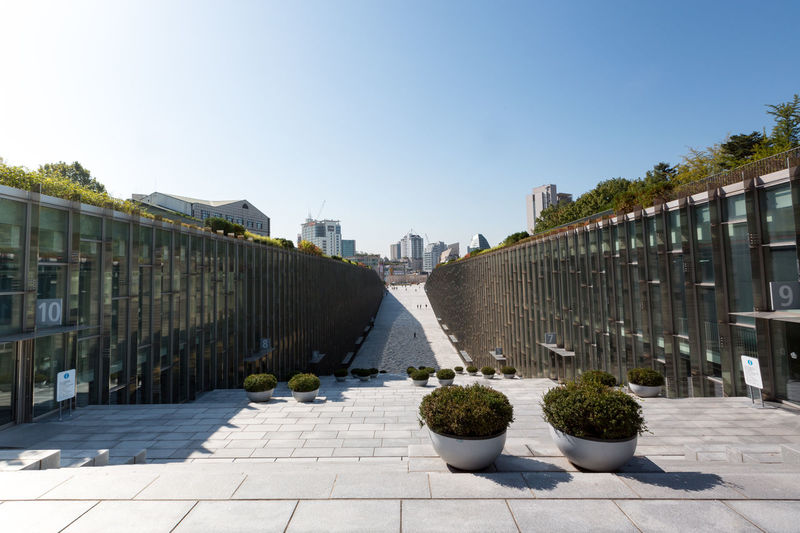 Campus of EWHA - Woman's University of Seoul, south Korea. Architket: Dominique Perrault Architecture Perrault Seoul Seoul, Korea Architecture Building Exterior Built Structure City Clear Sky Day Ewha Ewha Womans University Nature No People Outdoors Plant Shadow Sky Sunlight Sunny Tree
