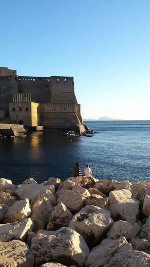 Naples Travel Destinations Built Structure Horizon Over Water Water Child And Mother Clear Sky Day Travel In Italy Castel Dell'ovo Visit Naples Autumn Italy Blue Tranquil Scene Beauty Italianlandscape Castle Cityscapes Italian City