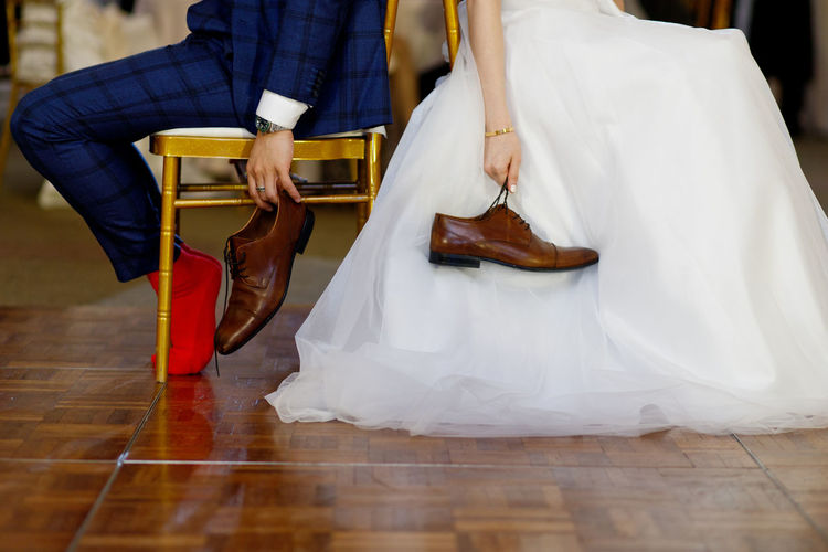 Wedding Shoe Game, party time. Real People Low Section Midsection Flooring Arts Culture And Entertainment Indoors  Women Hardwood Floor Holding Lifestyles Wood Leisure Activity Clothing Human Body Part Human Leg Bride And Groom Wedding Dress Shoe Game Question Answer Full Frame Laughs Audience Celebration Event