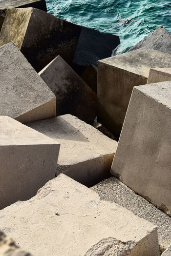 Concrete cubes strengthening the shore from the sea. Abstract architectural form Architectural Form Architecture Coastline Concrete Cubes Abstract Architectural Detail Architecture Beach Block Shape Coast Concrete Cube Shape Land Nature No People Outdoors Sea Seascape Shadow Solid Strengthening Water