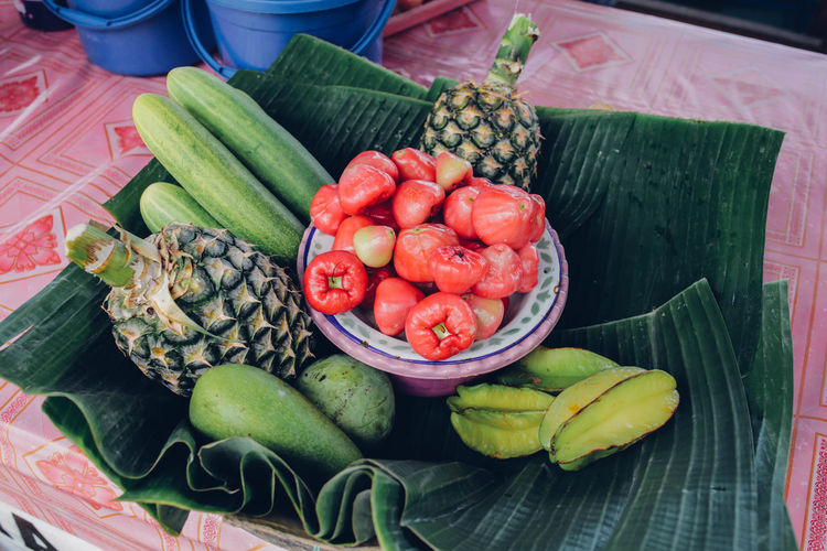 High Angle View Of Various Fruits On Banana Leaves At Table