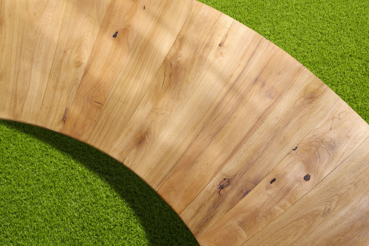 High angle view of wooden table in lawn