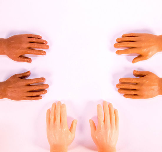 Cropped image of people with hands