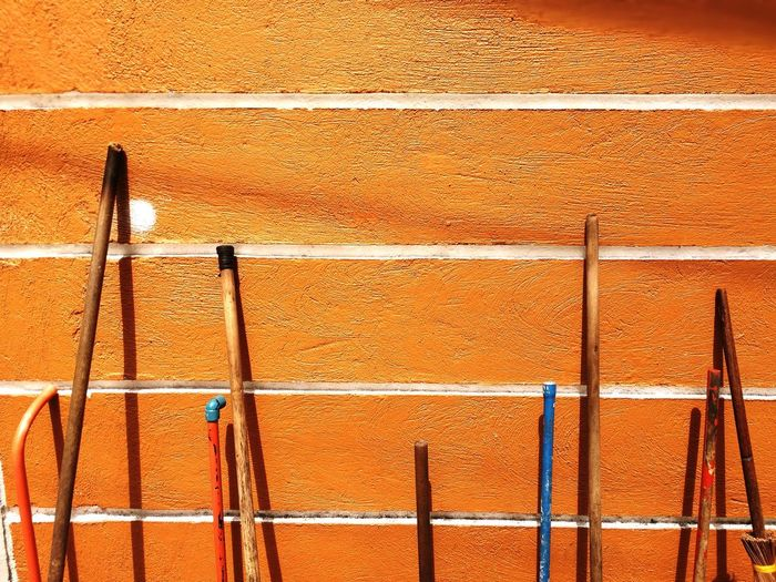 Broom Sticks Wall Sticks Rod Abstract Built Structure Day No People Pattern Architecture Wall - Building Feature Sunlight Outdoors Backgrounds Shadow Textured