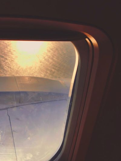 Aerial view of sky seen through airplane window