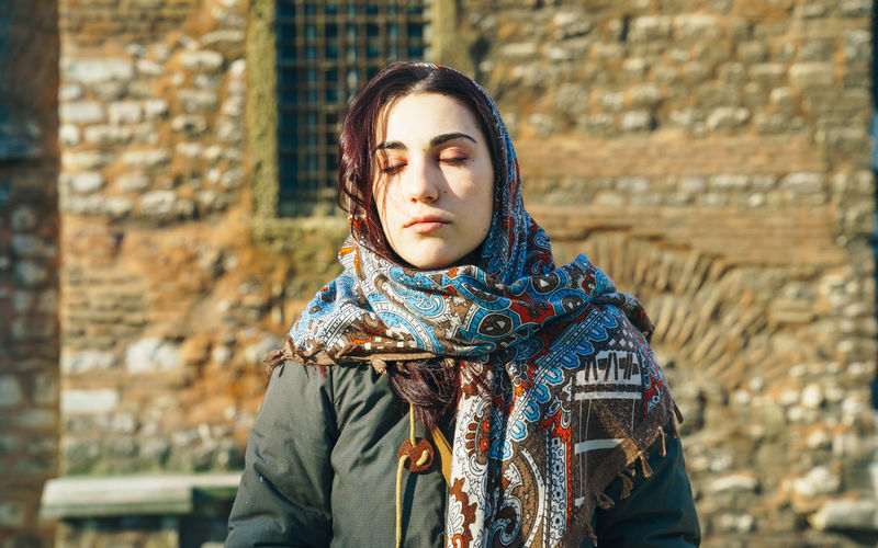 Church Eyes Closed  Adult Adults Only Beautiful Woman Close-up Day Lifestyles One Person Outdoors People Period Costume Portrait Real People Scarf Warm Clothing Young Adult Young Women