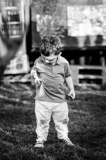 Rear view of boy standing on field