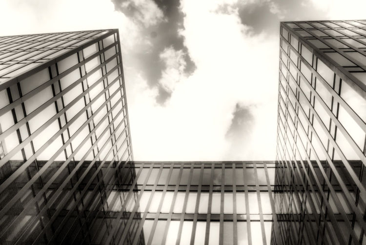 Modern architecture in Hafen City Hamburg Architecture Building Exterior Cloud Cloud - Sky Cloudscape Cloudy Connection Development Engineering Low Angle View Modern No People Outdoors Overcast Power In Nature Sky Smoke Storm Cloud Structure Weather
