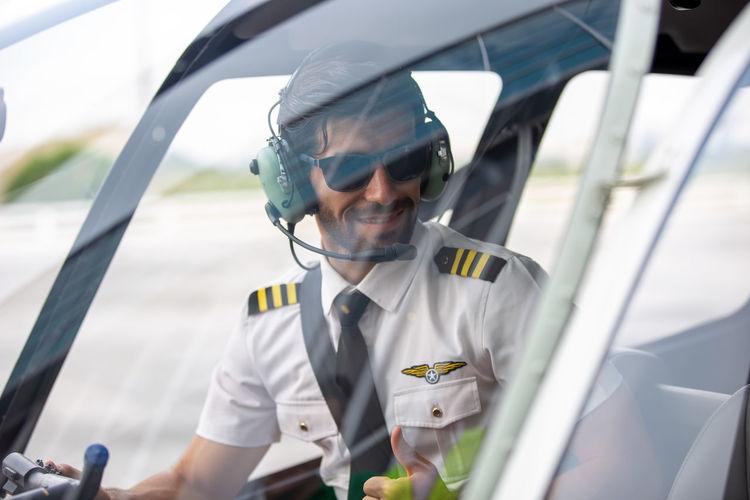 Close-up of pilot siting at cockpit