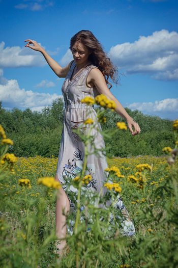 Beautiful Woman Women Long Hair Sky One Person Cloud - Sky Nature Hair Hairstyle Field Flower Young Women Standing Yellow Plant Lifestyles Leisure Activity Flowering Plant