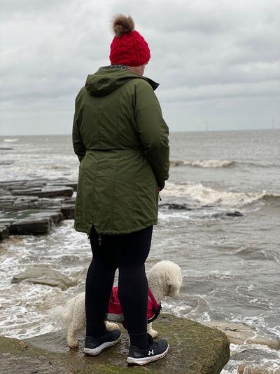Rear view of woman looking at sea shore