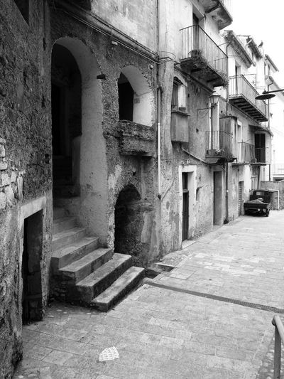 Glimpse with stairs Black & White Doors Historic City Italia Old Town South Italy Stairs Architecture Black And White Black And White Photography Building Exterior Built Structure Calabria No People Outdoors Street Travel Destination Verbicaro