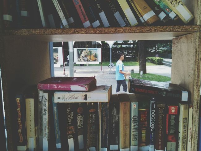 Books Real People Standing Focus Object Opened Book Makati City, Philippines Makati Triangle Reading Books