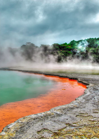 Beauty In Nature Cloud - Sky Day Erupting Geology Geyser Heat - Temperature Hot Spring Landscape Nature New Zealand No People Outdoors Physical Geography Power In Nature Scenics Sky Smoke - Physical Structure Steam Tranquility Travel Destinations Volcanic Landscape Wai O Tapu Water