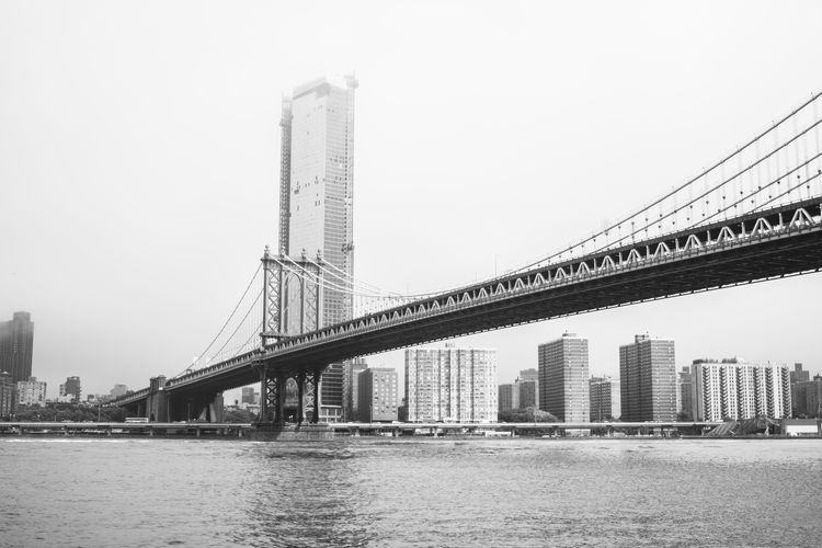 Hudson River New York Architecture Bridge City Cityscape Manhattan Bridge Modern Outdoors Skyscraper Travel Destinations Water Waterfront
