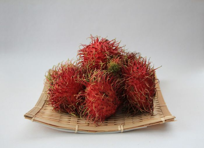 Studio Shot Red Still Life Food And Drink White Background Food Indoors  Close-up Healthy Eating No People Fruit Freshness Wellbeing Cut Out Tropical Fruit Large Group Of Objects Container Table Spiked Plant Lychee Rambutan Rambutan Fruit Rambutans Thailand