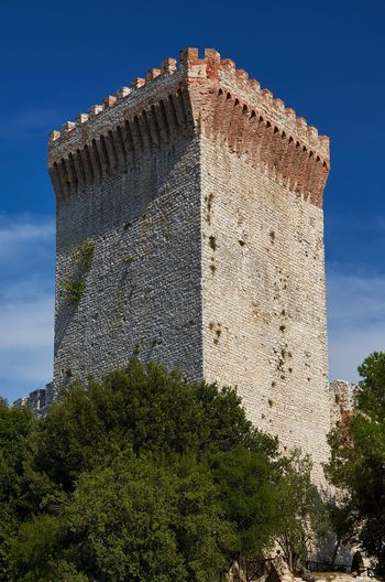 Fortress tower, Castiglione del Lago, Umbria Italy Umbria Castiglione Del Lago Blue Sky Tower Architecture Brick Built Structure Historic Historical Building Fort Fortress Fortification Fortress Of The Lion Low Angle View The Past No People Outdoors Weathered Lines And Shapes