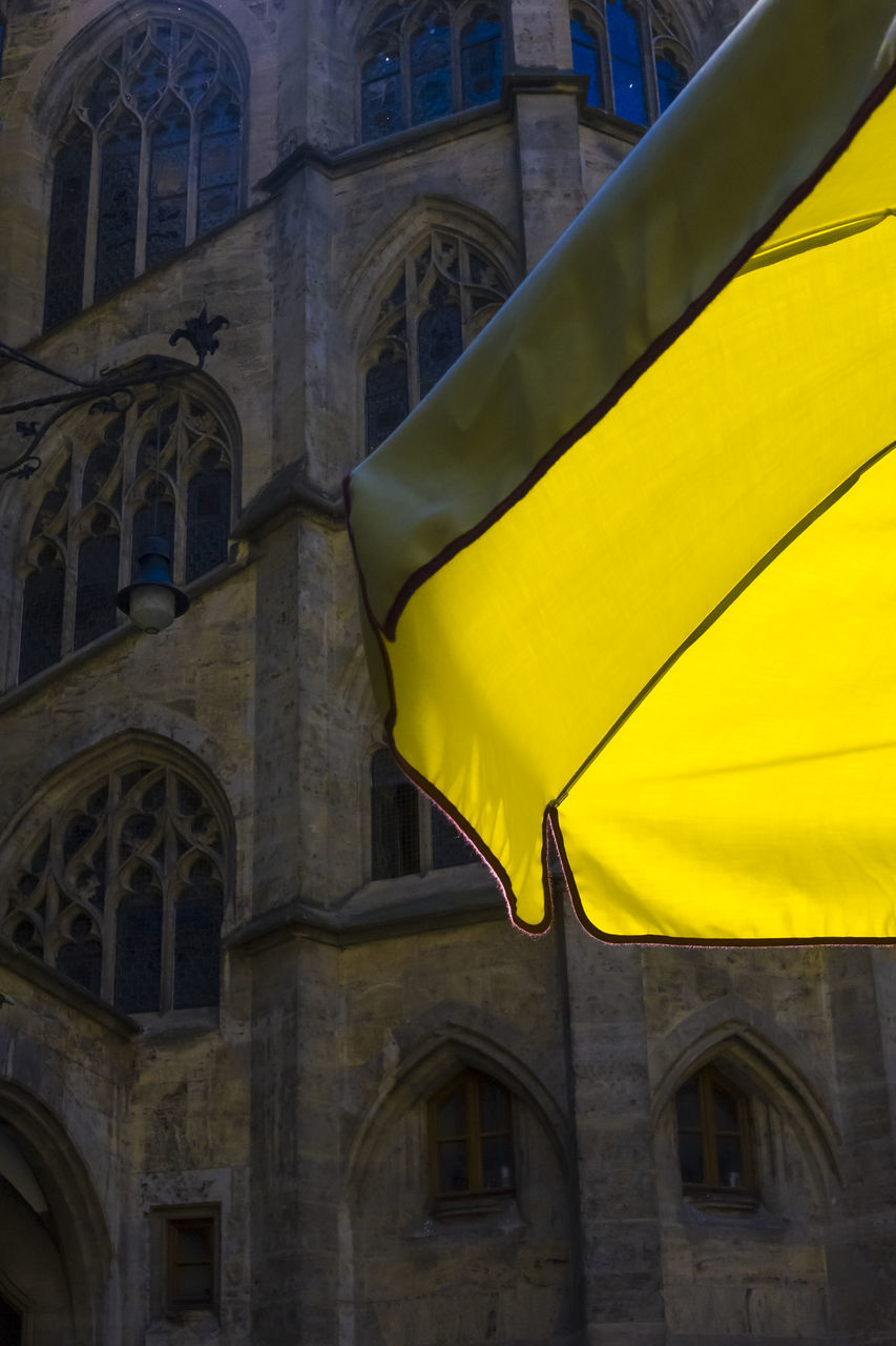 architecture, building exterior, built structure, yellow, low angle view, building, no people, flag, window, day, patriotism, history, outdoors, the past, arch, place of worship, religion, belief, spirituality