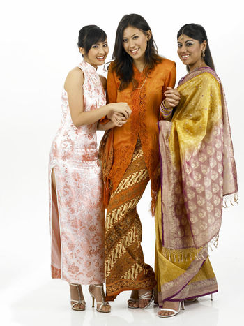 malaysia young woman in traditional costumes Friends Holding Hands Indian Looking At Camera Proud Traditional Clothing Baju Kebaya Cheongsam Chinese Friendship Happiness Harmony Malay Ethnicity Malaysian Merdeka Mixed Race Multi Racial Portrait Racial Sari Together Togetherness United White Background Women