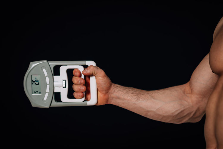 Hand Dynamometer Hand Dynamometer Device Equipment Technology Research Measure Object Meter Scale  Measurement Force Dynamo Physics Heavy Lift Vector Health Power Set Muscle Healthy Exam Care Energy Concept Checkup Check Arm Muscular Physical Close Up Therapy Tool Physical Therapy Gripping Medical Test Recovery Medical Exam Squeezing Fist Human Hand Black Background Holding Copy Space