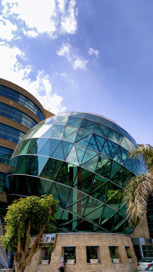 57357 Architecture Building Building Exterior Built Structure Cancer Hospital City Day Dome Futuristic Futuristic Architecture Glass Glass - Material Hospital Low Angle View Modern No People Outdoors Sky Skyscraper Sunlight Travel Destinations Tree