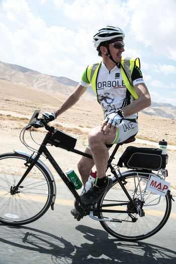 Balance Bicycle Bicycles Carefree Cycle Cycling Day Enjoyment Full Length Fun Happiness Helmet Land Vehicle Lifestyles Men Mode Of Transport Palestine Parked Parking Real People Riding Side View Stationary Transportation