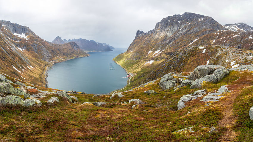 landscape view of Senja Island in Norway Barents Sea, Northern, Senja Island, Arctic, Atlantic, Coast, Cold, Europe, Fishing, Fjord, Harbor, Holiday, Ice, Landscape, Mountains, Nature, Nordic, North, North Sea, Norway, Norwegian, Ocean, Outdoor, Polar Circle, Port, Scandinavia, Sea, Seascape, Sky, Spring, Summer, Tourism, Travel, Village, Water Water Beauty In Nature Mountain Sky Tranquility Tranquil Scene Cloud - Sky Scenics - Nature Rock Nature Non-urban Scene Mountain Range No People Rock - Object Day Lake Idyllic Solid Environment Formation