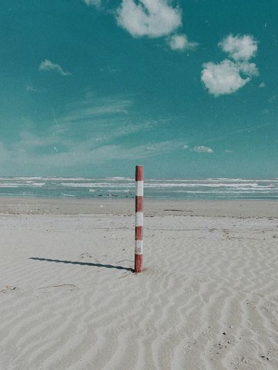stripes Beach Land Sea Water Sky Nature Tranquility Beauty In Nature Scenics - Nature Sand Safety Day Horizon Over Water Tranquil Scene Outdoors No People Cloud - Sky