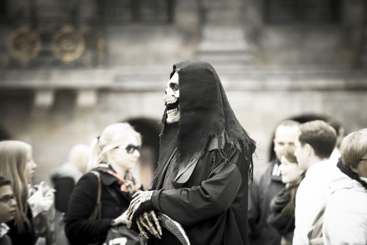 Street performer wearing devil mask