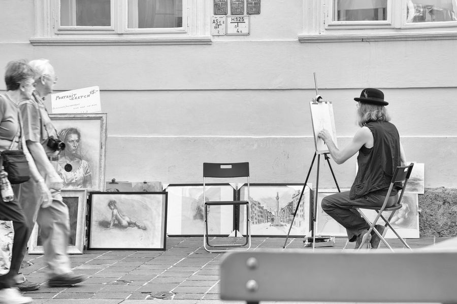 Have a seat, please. Architecture Artist Building Exterior Built Structure Couple Day Full Length Men Nusshain 05 17 Outdoors Painter Painting Paintings People Real People Standing Two People Focus On The Story Painter - Artist Urban Scene