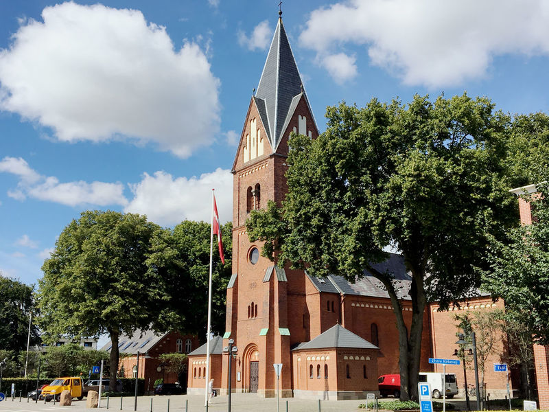 Travell to Europa-Denmark Architecture Building Exterior Built Structure Churches City City City Life Cloud Cloud - Sky Cloudy Day Denmark Façade Growth Low Angle View No People Outdoors Sky Stock Photograph Stock Photos Summer Tall - High Travel Travel Destinations Tree