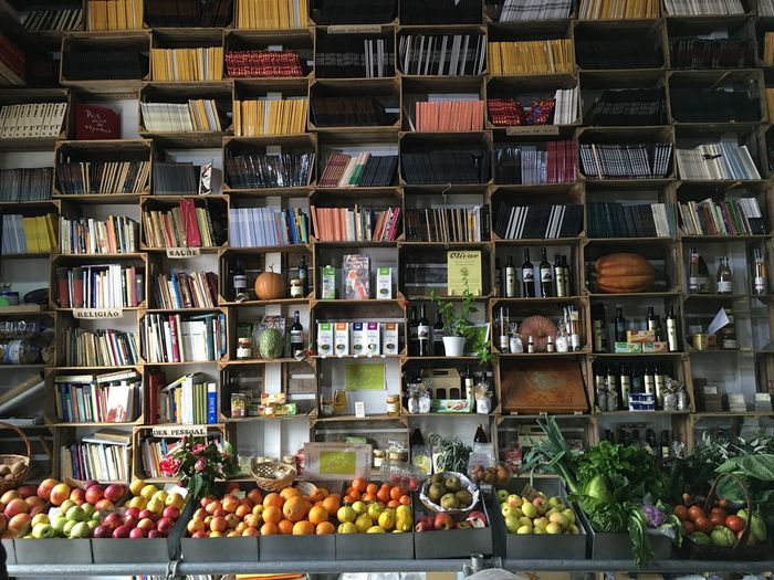 Abundance Arranged Arrangement Books & Fruit Buying Choice Collection Day Display Food And Drink For Sale Freshness In A Row Large Group Of Objects Multi Colored No People Order Repetition Retail  Retail Display Shelf Stack Strange Bookstore Variation Vibrant Color