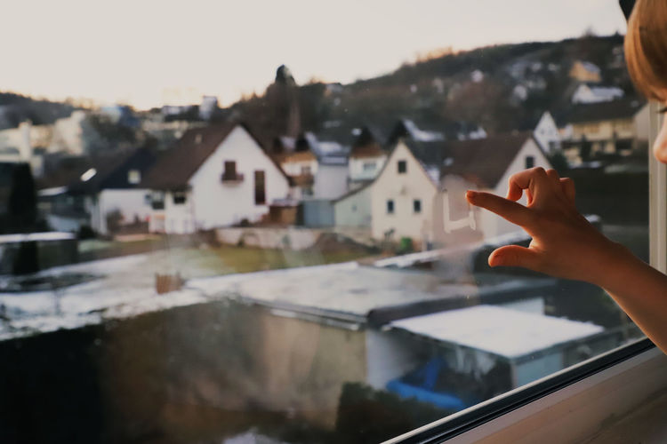 Window Drawing Finger Painting Paint Breath Childhood Child View Human Hand Hand Human Body Part Built Structure Real People One Person Human Finger Finger Architecture Building Exterior Lifestyles Body Part Unrecognizable Person Focus On Foreground Holding Leisure Activity Day Building House