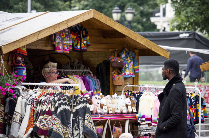 People at market stall
